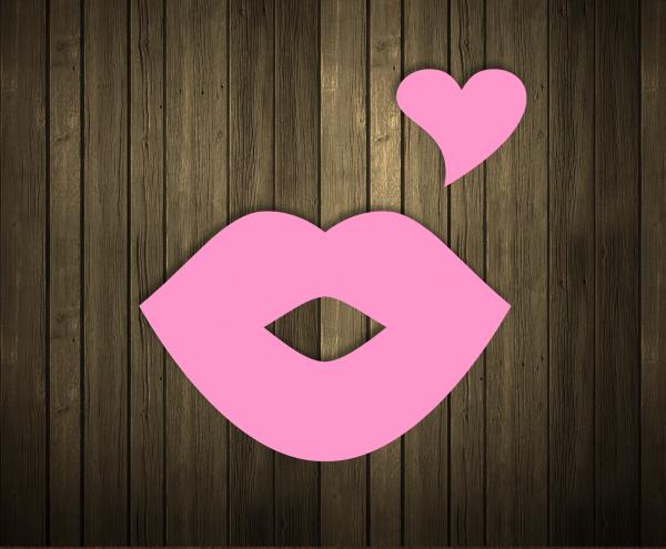 Kissing lips and heart shape